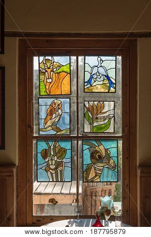 NIEU BETHESDA SOUTH AFRICA - MARCH 22 2017: Locally made stained glass windows in the community arts centre in Nieu-Bethesda an historic village in the Eastern Cape Province