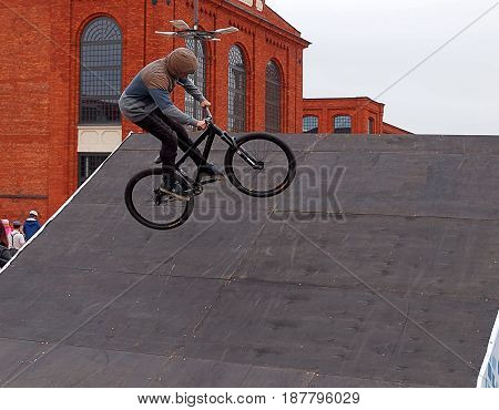 Bicycle style free. Lodz, Poland - May 21, 2017 Young biker cycling on bike, at a bicycle festival in Manufaktura shopping center in Lodz.