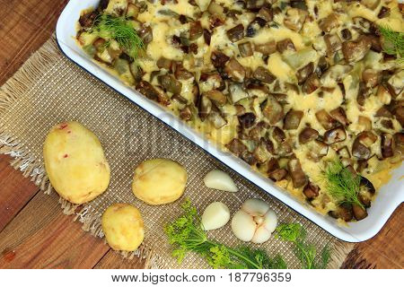 dish from fried pieces of eggplants covered by processed cheese
