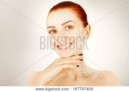 young red haired woman closeup with surgery lines