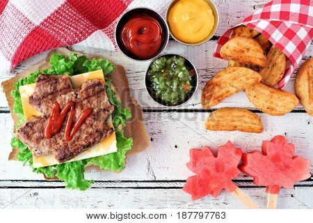 Canada Day Picnic Scene With Maple Leaf Shaped Hamburger, Watermelon Pops And Potato Wedges