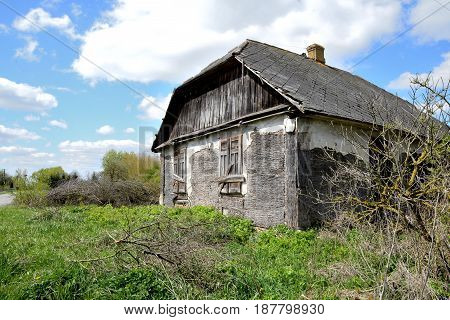 Old wooden abandoned house destroying the wasteland