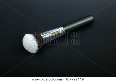 Professional make-up brush on black background, natural cloth,