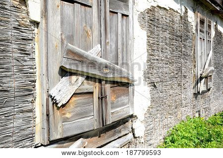Window of an old wooden abandoned house destroying in the wilderness