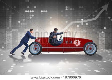 Businessman car pushing in teamwork concept