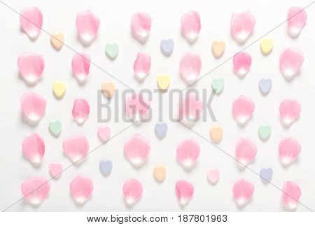 Candy Hearts And Rose Petals On A White Background