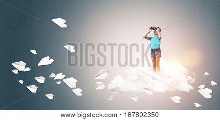 Cute kid girl standing on cloud looking in binoculars and paper planes flying around