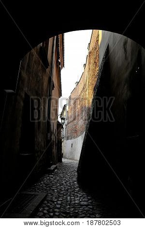 A narrow alley in the old town of Lublin overlooking the sky