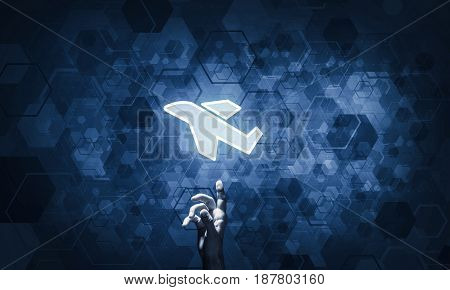 Hand of businessman pressing with finger airplane icon on dark background