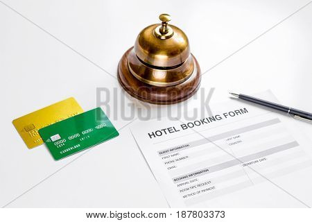 hotel reservation blank and ring on white desk background