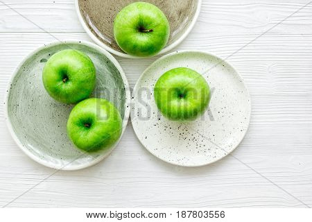 fresh organic green fruits with apples on white desk background top view
