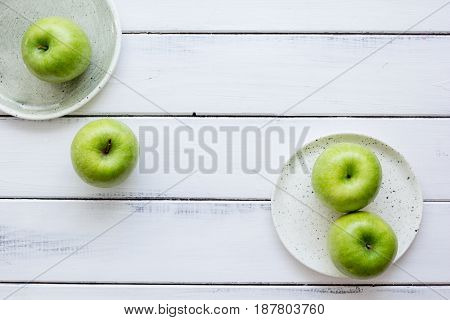 fresh organic green fruits with apples on white desk background top view mock-up