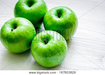 fresh organic green fruits with apples on white desk background