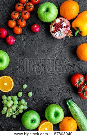 Organic fruits and vegetables for healthy dinner on darkbackground top view mock up