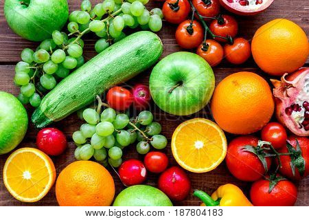 fresh vegetables and fruits for fitness dinner on wooden desk background top view