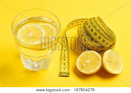 Measuring Tape, Lemon With Freshly Squeezed Glass Of Citrus