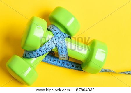 Aerobics Concept With Dumbbells And Measuring Tape