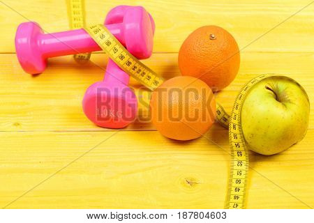 Fruit And Health Concept, Dumbbells Weight With Measuring Tape
