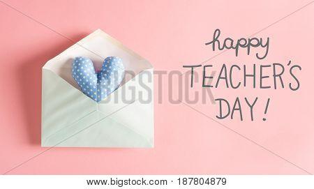 Teacher's Day Message With A Blue Heart Cushion