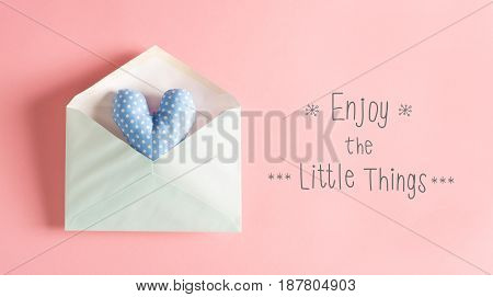 Enjoy The Little Things Message With A Blue Heart Cushion