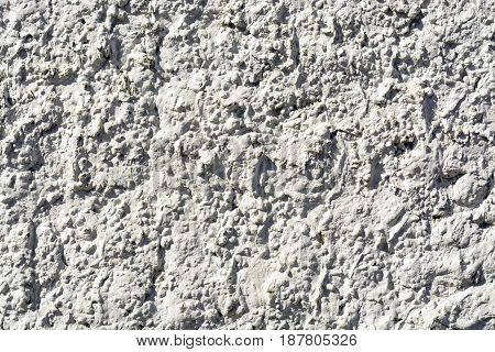 the texture of the white cement walls in a Sunny day