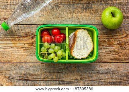 healthy food in lunchbox for dinner at school on wooden table background top view
