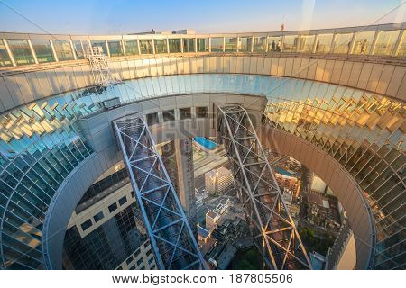 Osaka, Japan - April 28, 2017: Floating Garden Observatory in Kita-ku district at sunset. A circular rooftop observation deck connecting the twin towers of Umeda Sky Building.Popular landmark in Osaka
