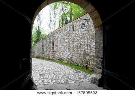 Medieval stone entrance gate to the Benedictine monastery in Tyniec