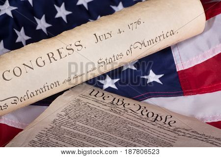 Declaration of independence and constitution on an american flag