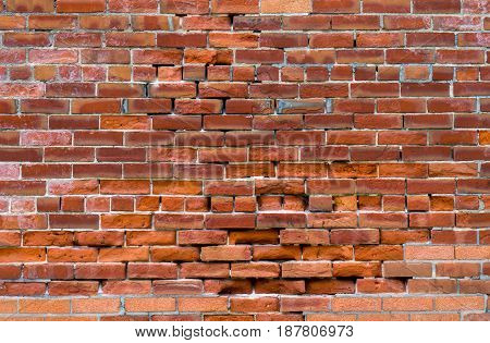 Distressed red brick wall background or backdrop in horizontal.