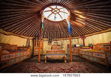 Traditional colorful yurta interior from the nomadic people in Kalmykia, Russia
