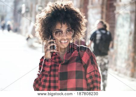 Girl With Afro Hairstyle Using Smart Phone.