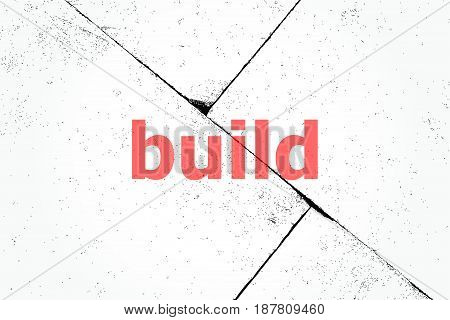 Text Build. Business Concept . Closeup Of Rough Textured Grunge Background