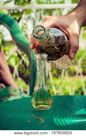 Pouring Domestic Brandy From Bottle Into Glass