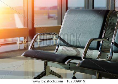 Passenger seat in Departure lounge of airport terminal