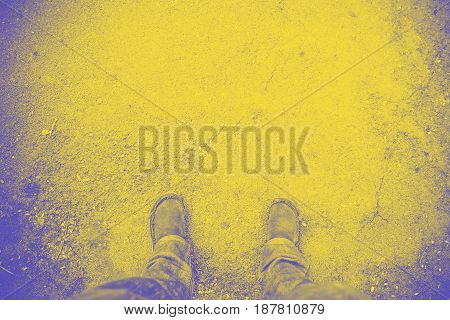 Blue and yellow Duo tone of aerial view of foot on concrete floor abstract background leave space for adding your text.