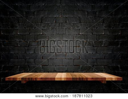 Empty wooden shelfs on pastel grunge black brick wall Mock up template for display of product.