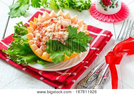 Original festive salad with grapefruit and crabmeat. Served in cups from grapefruit peel with lettuce. Idea of festive snack for Valentine's Day Mother's Day birthday. Red shades in decoration