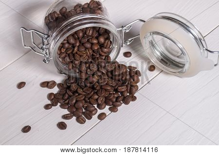 The Scattering Of Coffee Beans Espresso Of Transparent Banks
