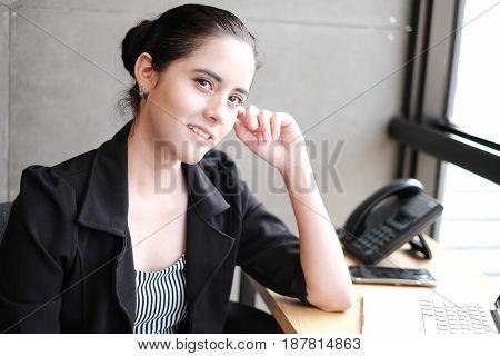 Portrait Of Happy Businesswoman In Office, vintage look