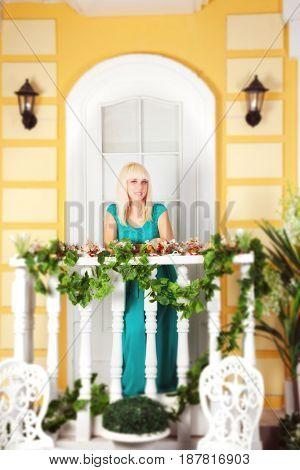 Beautiful blond in blue formal dress