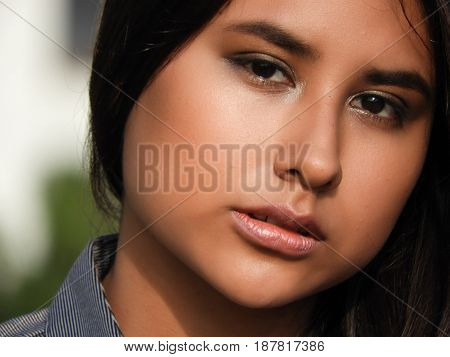A Sad Face Of Peruvian Teen Close Up
