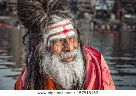 Portrait of sadhu smiling in the boat, Varanasi, India.