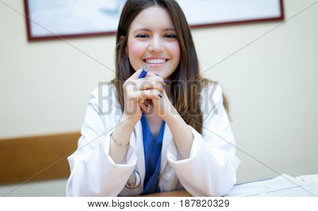 Young female doctor in her studio