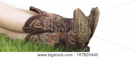 Cowboy boots. Brown boots. Rural boots. Woman legs crossed. Female boots. Girl wearing boots. White background. Nubuck leather
