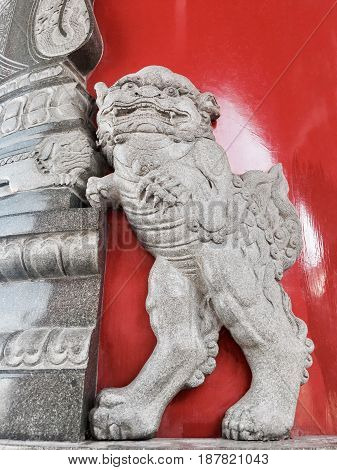 Ancient Chinese Lion Stucco or Guardian Lion at The Wall of Chinese Temple Symbol of Protection and Power in Oriental Asia Especially China.