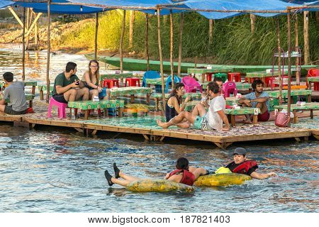 Vang Vieng, Laos - January 19, 2017: Tourist enjoy tubing in Song River at Vang Viang, Laos.