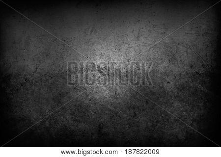 Closeup of textured grey wall, dark edges