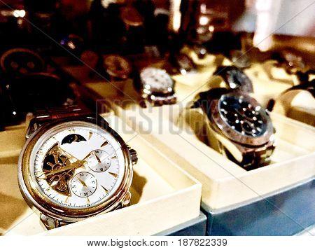 Time Management Concept Classic and Luxury Wristwatch in A Collectible Display Glass Cabinet.