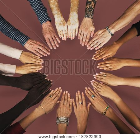 Group of hands assemble together in aerial view